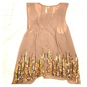 Sheer sleeveless blouse with metallic sequins